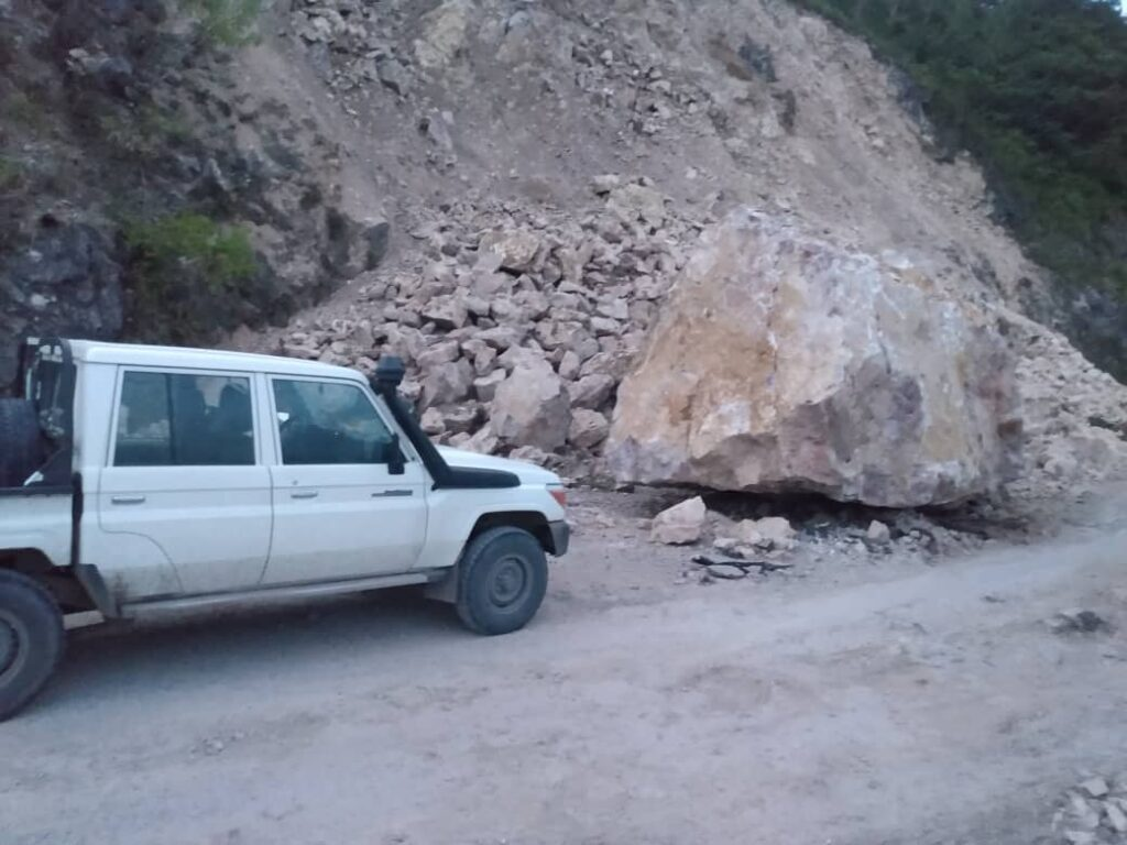 Truck stopped at boulder on way to Jeremie