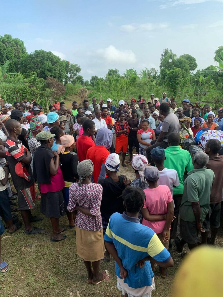 Etienne organizing a medical clinic in Charlette, a town now accessible only by helicopter